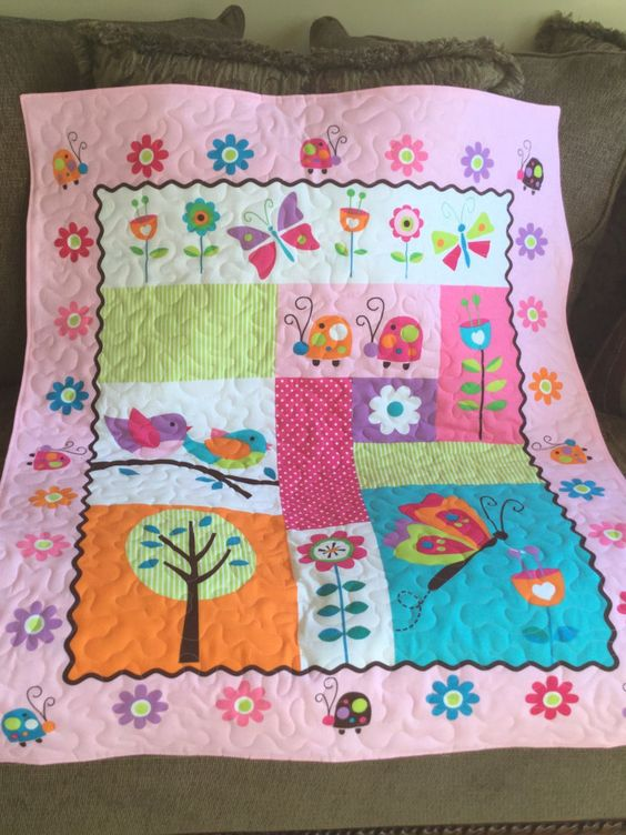 A personal favorite from my Etsy shop https://www.etsy.com/listing/266921922/baby-quilt-with-matching-fabric-book