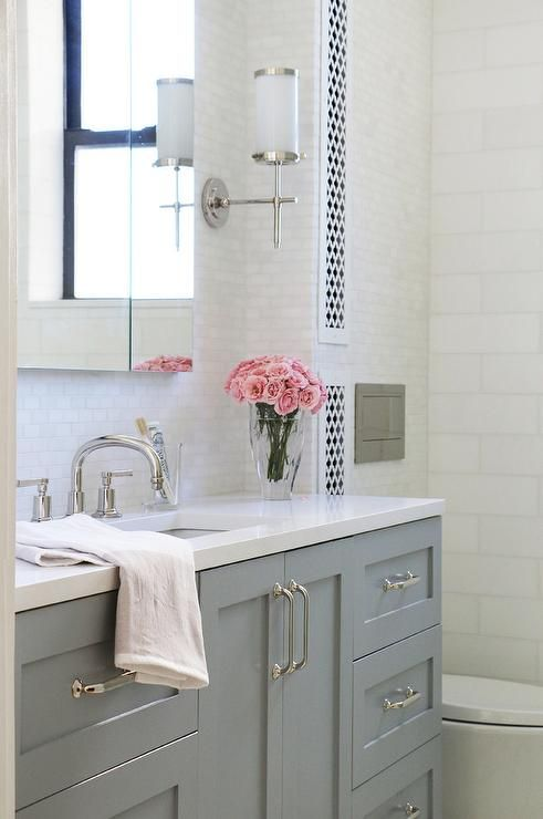 Gray Bath Vanity Displays Gray Shaker Cabinets Accented With
