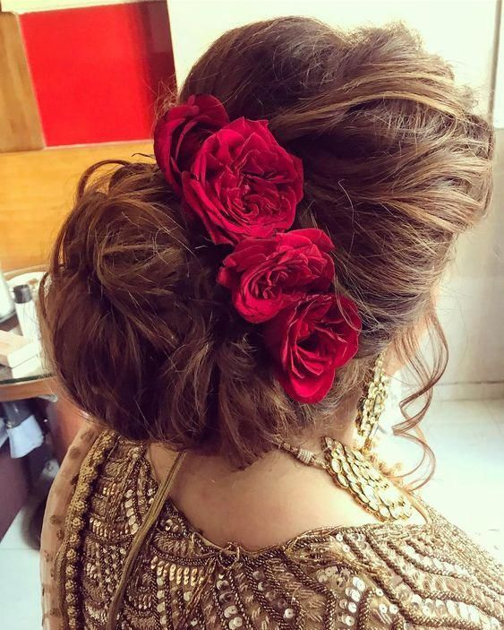 Indian Bridal Hairstyles Inspiration Messy Hair Buns Adorned With Red Roses Indian Brida Bridal Hair Buns Indian Wedding Hairstyles Bridal Hair Inspiration