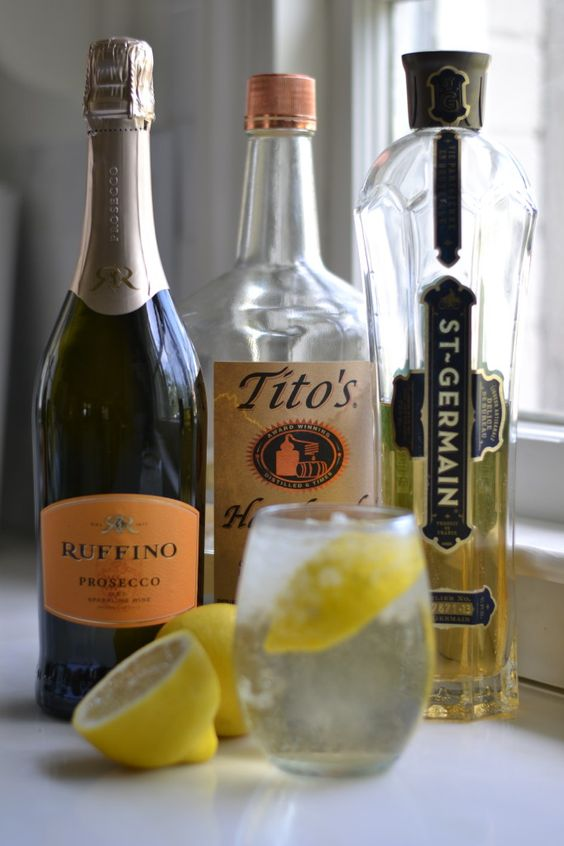 THE MAE MAE, by @stylegathering | 1 1/2 shots of Tito's Handmade Vodka, 1 cap of St. Germain Elderflower Liquer, champagne or club soda, & Meyer Lemon juice. | Fill a glass with ice. Add Tito's and St. Germain to the glass. Top with champagne, prosecco or club soda. Squeeze in the juice of 2-3 lemon wedges. Stir and serve.