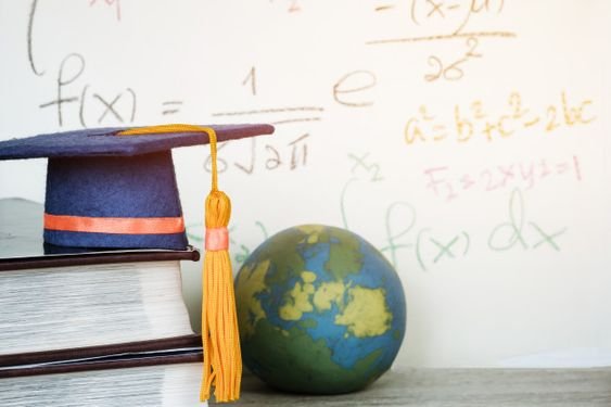 Education graduate mortarboard blue hat on textbook with formula equation mathematics Photo | Premium Download