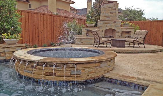 Custom circular spa, with 1' ports, mosaic tiles and flagstone cap