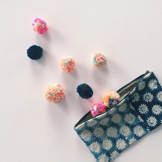 Oh the colorful seussicle pom-poms of @crosekauf. They perfectly encapsulate Caroline's joie de vivre. #12daysofpouches