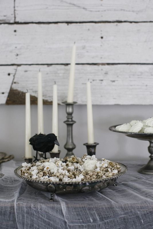 Mismatched vintage candlestick holders are the perfect finishing touch on a spooky Halloween dessert table