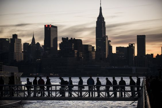 Manhattan from Hoboken, N.J.  People board the NY Waterways ferry with the Manhattan skyline in the background Nov.1, 2012 in Hoboken, New Jersey. Hurricane Sandy, which made landfall along the New Jersey shore, left parts of the state and the surrounding area without power including much of lower Manhattan south of 34th Street.