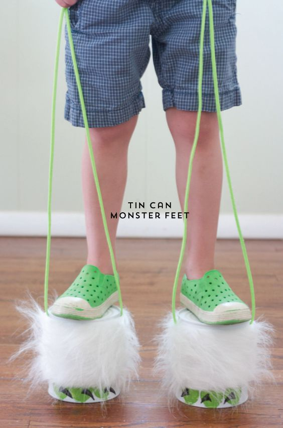 tin can monster feet ~ simple recycled kids craft. Tin can stilts.