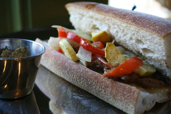 Spicy veggies on baguette w/ pesto oil