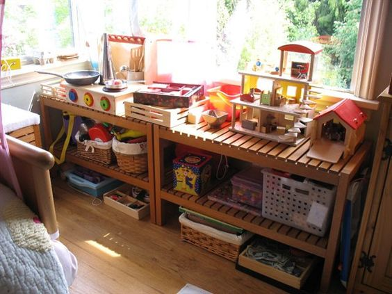 Low shelves with baskets for toys