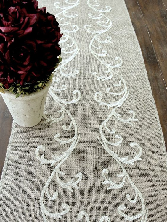 This beautiful table runner is made of 100% natural burlap and decorated with antique shimmering gold , silk and metallic ,19th-C French inspired embroidery.  Sise: 14 X 74  All my runners edges are surged on the and will not fray.  The runner is customizable in your requested size.  Thank you for taking in consideration my work!!! :)