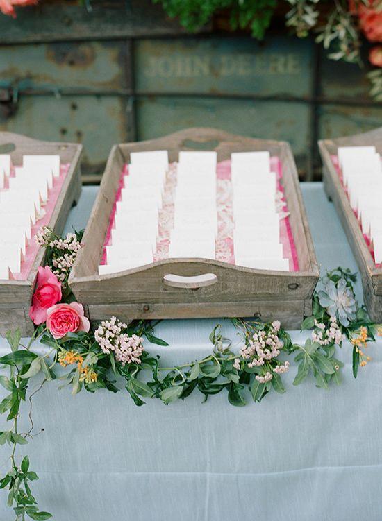 cute escort card table with wooden trays #escortcards #weddingreceptions #weddingchicks http://www.weddingchicks.com/2014/02/05/dos-pueblos-ranch-wedding-2/: