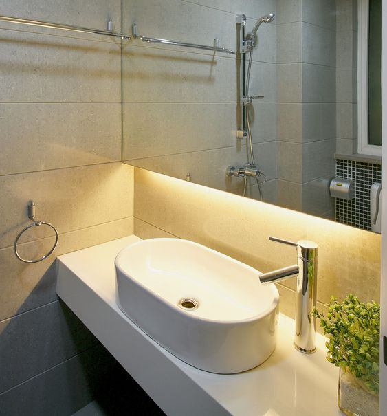 beautiful under cabinet bathroom lighting created by using warm white led strip lights http beautiful lighting uk