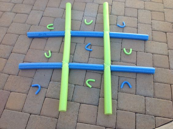 This is an easy game to make for kids. I purchased four pool noodles and two packages of jumbo foam rollers from the dollar store.  You will need eight zip ties to connect the noodles. I cut a two inch notch on each noodle at 16 inches, like Lincoln Logs.  Fit the pieces together and fasten with the zip ties. This can be used in several ways. On the lawn or sidewalk as Tic, Tac, Toe. For more of a challenge toss the foam markers from a short distance away. You can also stand it up and toss…