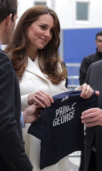 Catherine, Duchess of Cambridge received a personalised Henri Lloyd t-shirt for Prince George by emblazoned with his team's logo by Sir Ben Ainslie during a visit to Portsmouth to see the construction site of Ben Ainslie Racing new headquarters and visitor centre at the Spinnaker Tower on February 12, 2015 in Portsmouth, England.: