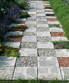 The checkerboard path features alternating squares of for Checkerboard garden designs
