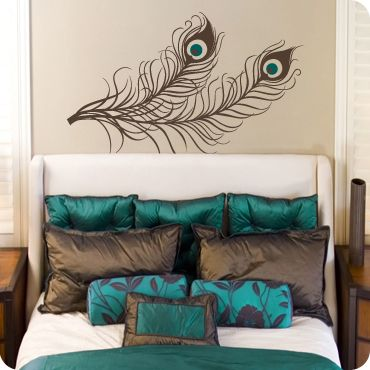 Kind of liking the peacock feather ... and it would be a good way to introduce a jewel blue to my red/brown/jewel tone room. I love those pillows at the back of the bed, too. Perfect jewel tone to match my green & amber pillows.: