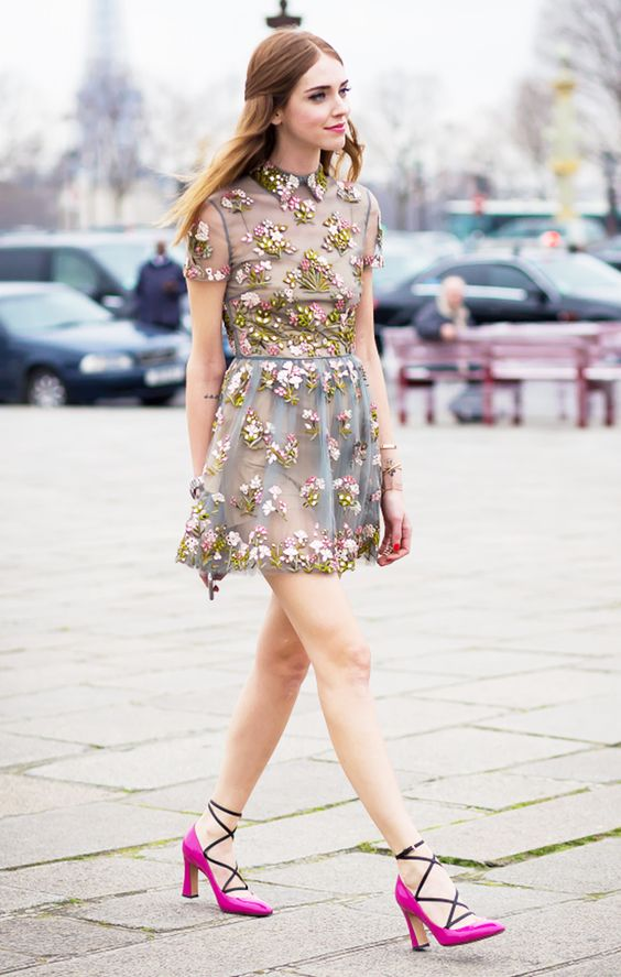 Chiara Ferragni in an embroidered floral dress and bright pink heels