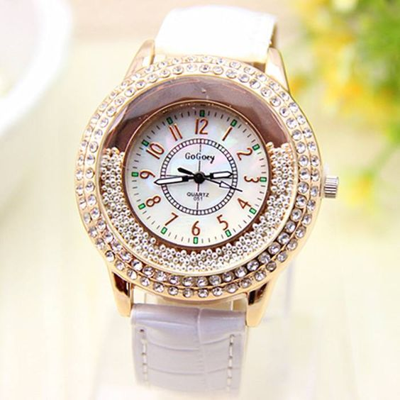 **Sold Out** White Large Gold Face Rhinestone Strap Watch  $45