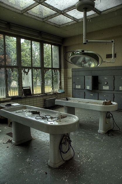 """Mortuarium Schoonselhof, Antwerp, Belgium. """"This morgue was abandoned some years ago; they left all tools and chemicals in its place. We found autopsy instruments untouched for years (we hope). There were some needles and sewing materials, a strainer scooper and electric bone saws. A chalkboard for recording examination data."""""""
