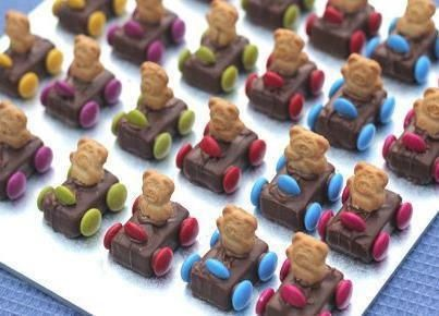 Teddy Bear Race Cars - Mars Bars - Smarties - Tiny Teddies  Mix 1/2 cup of icing sugar, 1 tsp cocoa powder, a few drops of hot water to make a paste and use as glue. Glue on 4 wheels then press on a steering wheel and glue on a teddy.  Great idea for kids!!