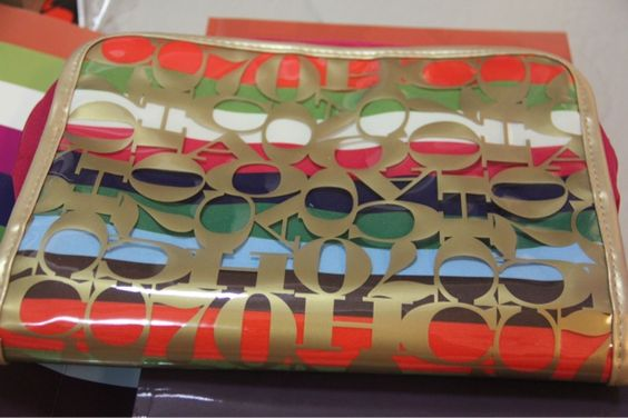i love this organizer bag :) coach 70years anniversary collection book gift:)