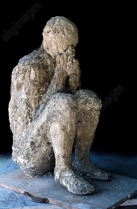 Body cast of victim of Pompeii eruption. The Roman city of Pompeii, located in the Bay of Naples, Italy, was ruined and buried under thick layers of ash during an eruption of the volcano Vesuvius in 79 AD. Many of those buried under the ash were killed by falling buildings or other causes, such as poisonous fumes. More