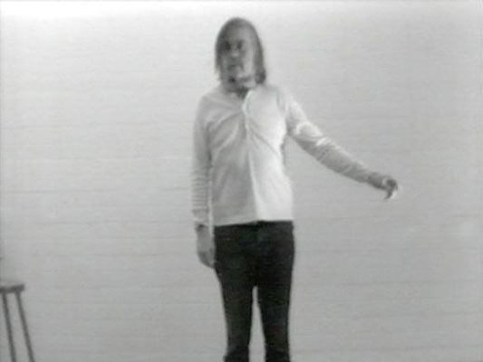 """In this video piece, Baldessari makes several arm movements, reciting the phrase, """"I am making art,"""" after each gesture.   Baldessari suggests that the gap between art and the ordinary, between art and life, may be imperceptible."""