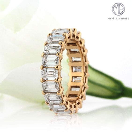 The emerald cut diamonds on this 18k rose gold eternity band are incredibly brilliant and stunning.