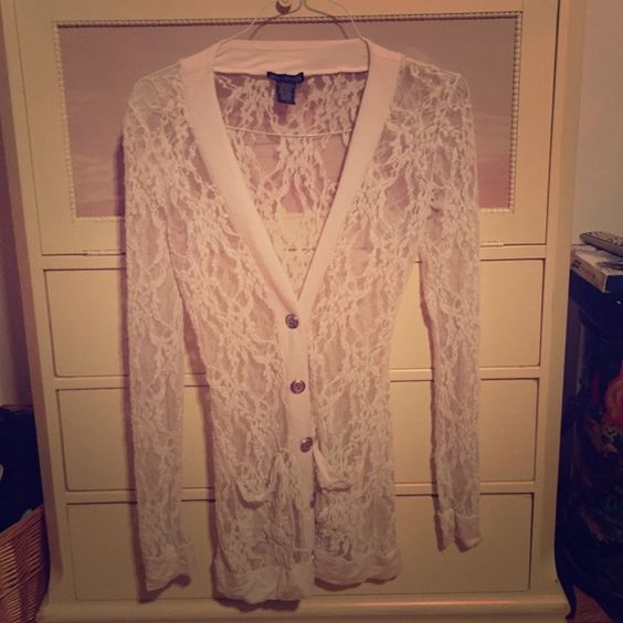 Long Lace Sweater ⭐️ Size large. Brand is Miss Chevious. This is in great condition and fits long. No major holes, tears or pulls. Cream color with silver buttons. ⭐️ Miss Chevious Sweaters