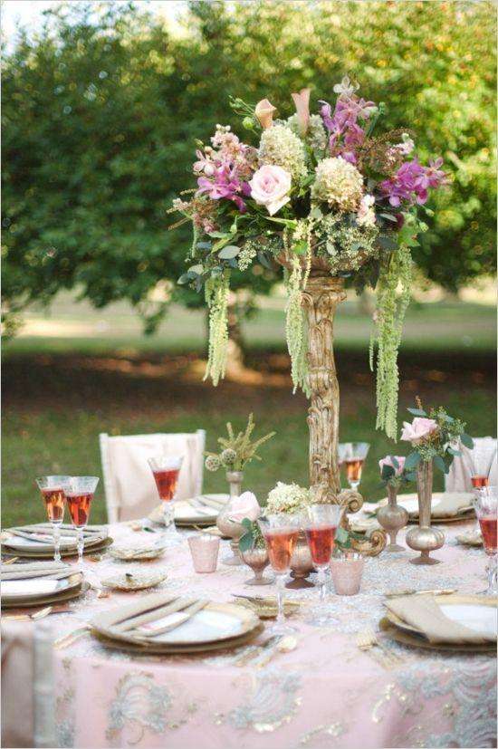 dramatic floral centerpiece by couture fleur #pinkwedding #bohowedding #weddingchicks http://www.weddingchicks.com/2013/12/26/pink-and-gold-wedding-ideas-2/