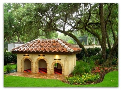 Mediterranean style custom dog house for three pups! #doghouse Amazing Dog Houses and Adorable Puppies to Pin