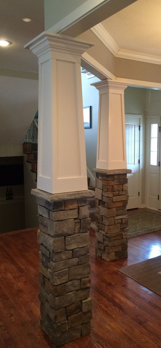 Tapered craftsman columns with stone base built over existing fiberglass columns.