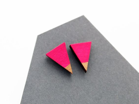 Theia design ▲ Wooden triangle stud earrings from the geometric collection ▲ Minimalist, modern jewelry ▲ hand painted, eco friendly jewelry ▲ hot pink (neon pink) and gold colors  Light, and modern jewelry - wear with fashionable, simple and modern clothes! :)   ...ABSOLUTELY HANDMADE JEWELRY...  The triangle is made of hardwood, and painted with dark magenta and gold color acylic paint. Finally I used rhodium plated studs. ▲ eco friendly jewelry! ▲