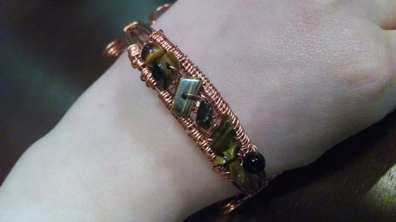 Copper wire wrapping bracelet with Tiger eye stones.