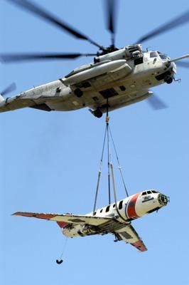 A Ch-53 Sea Stallion Lifts a Hu-25 Guardian Coast Guard Aircraft. : Custom Wall Decals, Wall Decal Art, and Wall Decal Murals | WallMonkeys.com