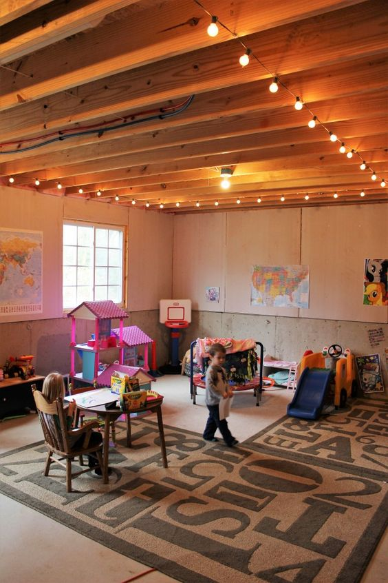 basement play room string lights kid cave unfinished basement kid toys storage and organization