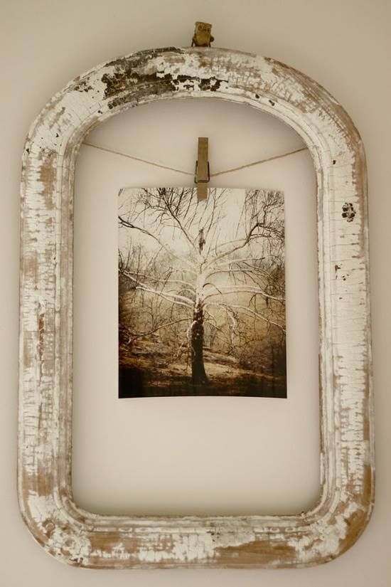 Recycle a vintage frame - hang picture using clothes pin on rope.  No glass needed - would work great for kid's art work too.