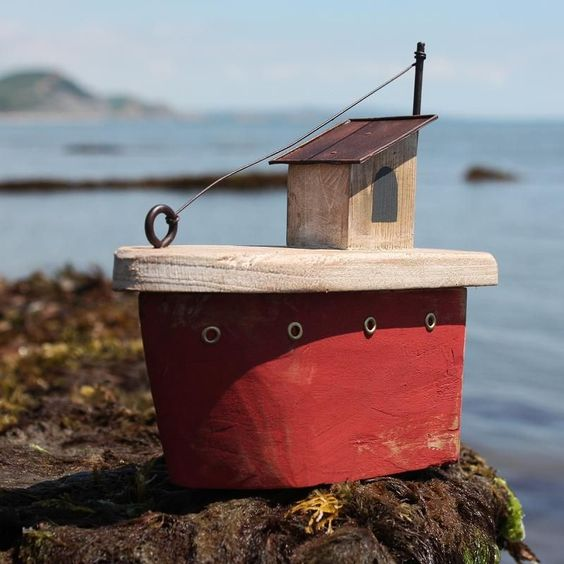 Full of charm, this red fishing boat is sure to find a place in your home. The simple decorative model boat has a distressed aged finish.