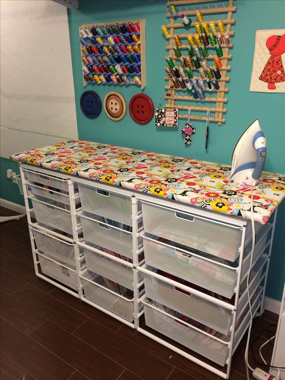 Quilting...ironing station with lots of fabric storage.:
