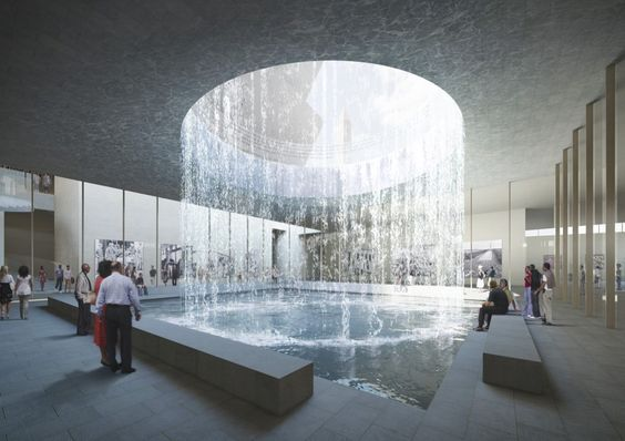 """Smithsonian National Museum of African American History and Culture :: """" symbolized by the memorial space – the """"oculus"""" – that brings light diffused by a cascade of water into the contemplative space from the Monument grounds.""""  """"An oculus, circular window, or """"rain-hole"""" (Latin: compluvium) is a feature of Classical architecture since the 16th century."""""""