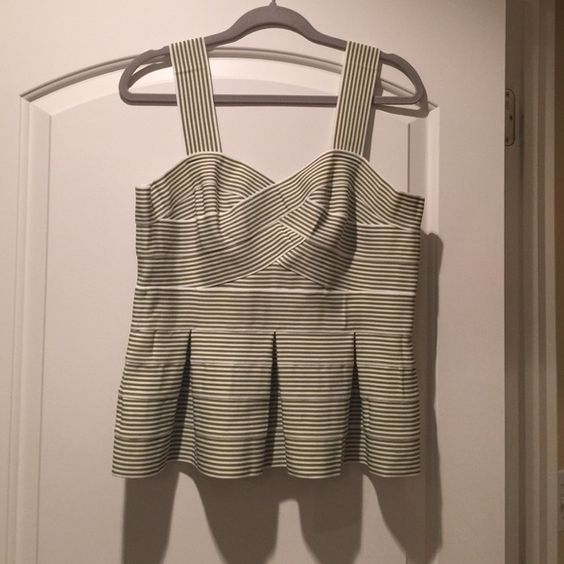 Green and off white stripped peplum top Green and off white stripped peplum top.  Made with stretchy material and double zippered back.  Pleated, very flattering. Anthropologie Tops Tank Tops