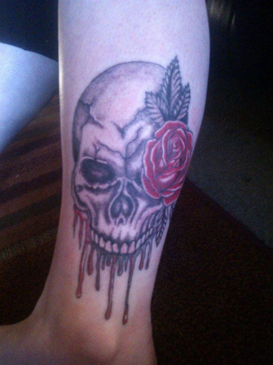 Bleeding skull and rose tattoo