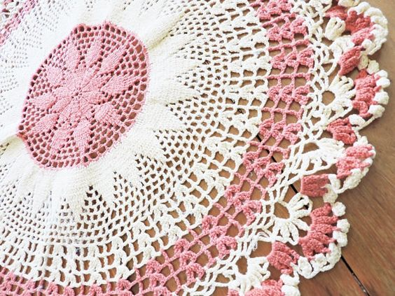 Large pink and white hand crocheted doily