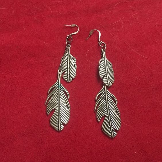 Silver feather earrings Some staining. PacSun Jewelry Earrings