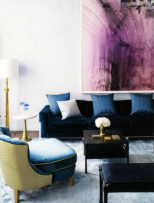 love the dark hues in this otherwise bright space. the large scale art is gorgeous!
