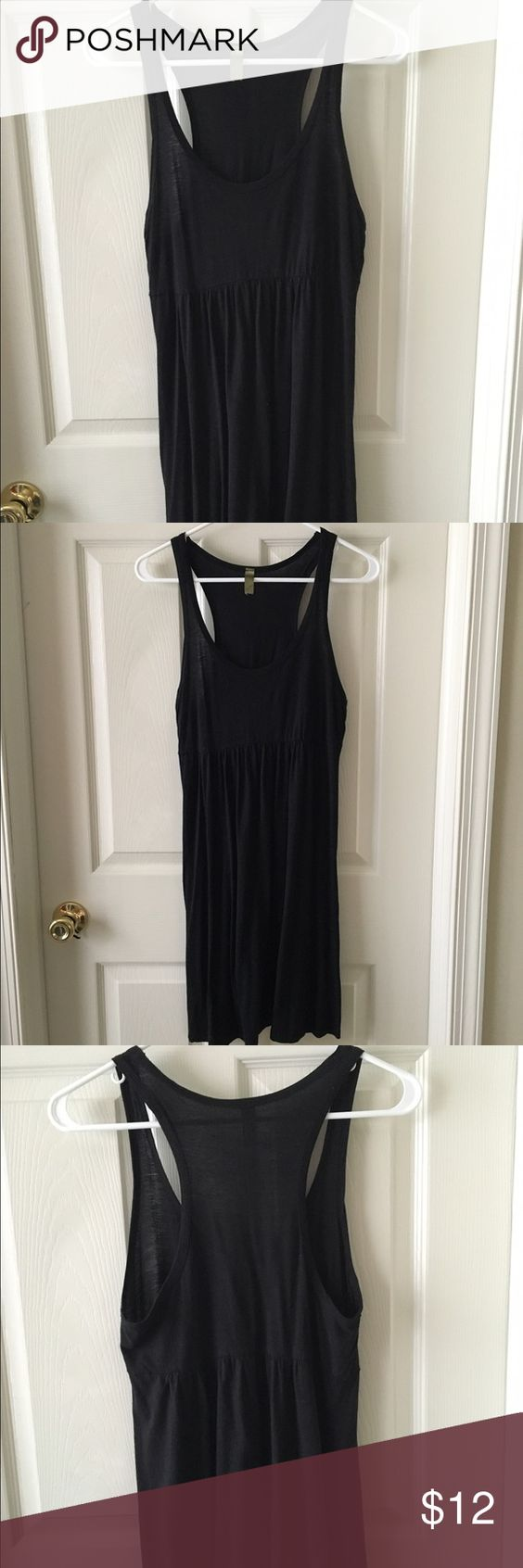 Black racer back sundress Simple little black sundress. Cinched a bit under the bust. Very comfortable and easy to throw on Lush Dresses Mini
