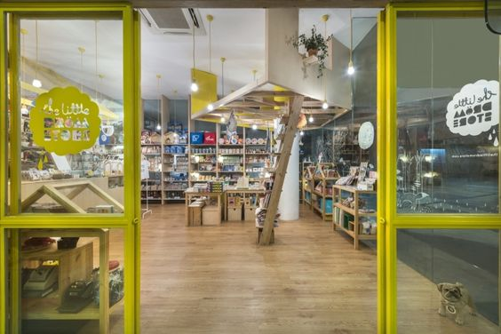 In the Kki Sweets section, volumes above the plane hints at the imaginary while the volumes below are adapted to practical requirements of eating and merchandising, forming tables and shelves, intimate interiors, and close-knitted exteriors.