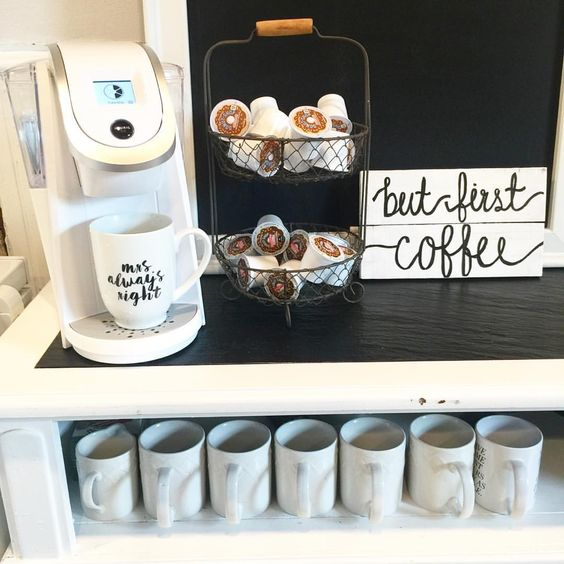 A home coffee bar can be such a calming and relaxing thing to wake up to in the early mornings.  Some essentials for a great coffee bar are coffee cups, a basket for your k-cups, mixers, To-go cups, k-cups, sugar, water for refills, coffee pot or Keurig, jars for toppings, and cake stands for fresh baked blueberry muffins.