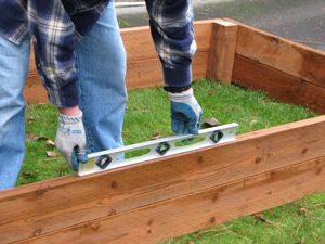 step by step construction directions for raised garden beds