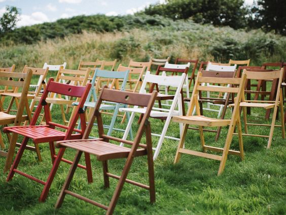 Our beautiful mismatch folding chairs all poised for the wedding guests. Birdcages and Dragonflies