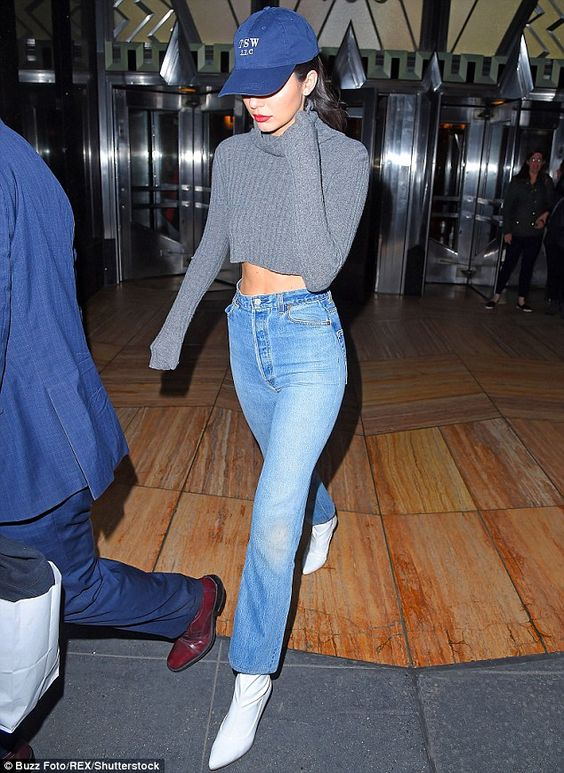 Top of the crops: Kendall Jenner continued her skin-flaunting display as she stepped out in New York on Thursday showcasing her toned midriff in a cosy cropped turtle neck: